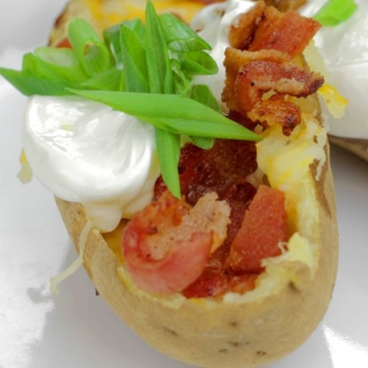 Michigan Loaded Potato Skins with garnish on plate